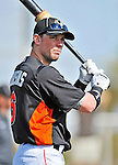 13 March 2012: Miami Marlins outfielder Scott Cousins awaits his turn in the batting cage prior to a Spring Training game against the Atlanta Braves at Roger Dean Stadium in Jupiter, Florida. The two teams battled to a 2-2 tie playing 10 innings of Grapefruit League action. Mandatory Credit: Ed Wolfstein Photo