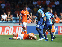 Blackpool's Chris Taylor clutches his face after being fouled<br /> <br /> Photographer Kevin Barnes/CameraSport<br /> <br /> The EFL Sky Bet League One - Wycombe Wanderers v Blackpool - Saturday 4th August 2018 - Adams Park - Wycombe<br /> <br /> World Copyright &copy; 2018 CameraSport. All rights reserved. 43 Linden Ave. Countesthorpe. Leicester. England. LE8 5PG - Tel: +44 (0) 116 277 4147 - admin@camerasport.com - www.camerasport.com