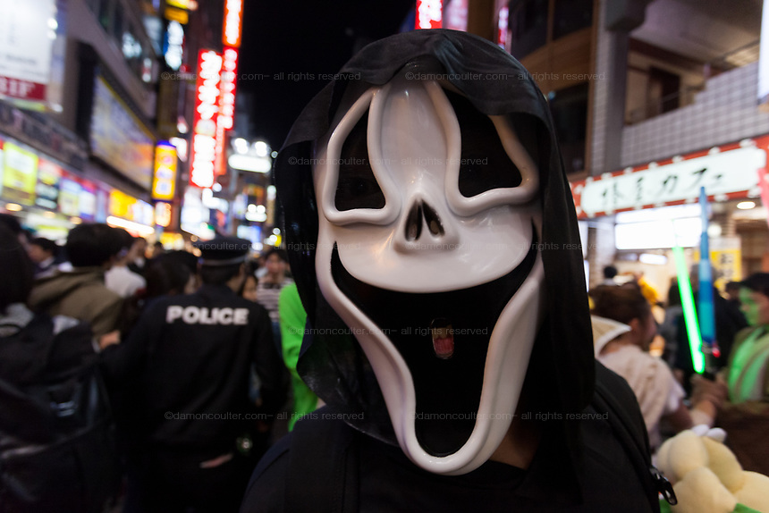 A man in a ghost mask enjoys the Halloween celebrations in Shibuya. Saturday October 28th 2017
