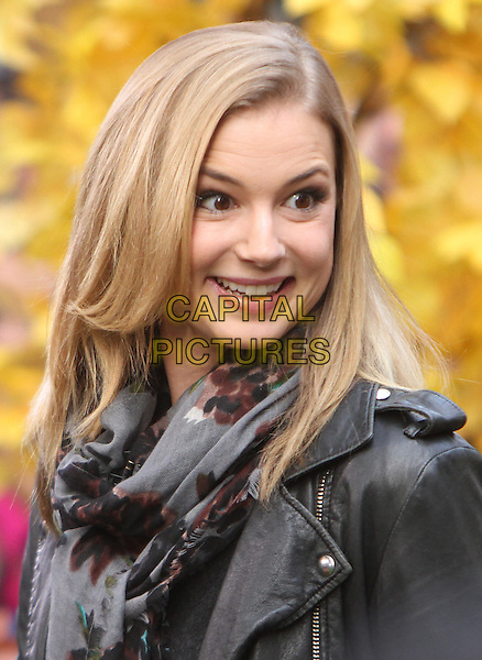 Emily VanCamp <br /> at Good Morning America promoting the 3rd season of ABC's Revenge, New York City, USA, September 27th, 2013.<br /> portrait headshot funny smiling black leather jacket grey gray print scarf <br /> CAP/MPC/RW<br /> &copy;RW/ MediaPunch/Capital Pictures