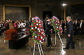 Washington, D.C. - October 30, 2005 -- United States President George W. Bush and first lady Laura Bush (obstructed) lay a wreath before the casket of civil rights icon Rosa Parks, whose remains lie in honor in the United States Capitol Rotunda in Washington, D.C. on October 30, 2005..Martin H. Simon - Pool via CNP