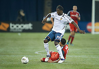 07 March 2012: LA Galaxy forward Edson Buddle #14 and Toronto FC midfielder Luis Silva #11 in action during a CONCACAF Champions League game between the LA Galaxy and Toronto FC at the Rogers Centre in Toronto..The game ended in a 2-2 draw.