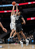 WASHINGTON, DC - JANUARY 28: Mac McClung #2 of Georgetown shoots over Henry Baddley #20 of Butler during a game between Butler and Georgetown at Capital One Arena on January 28, 2020 in Washington, DC.