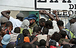 Desperate earthquake survivors in the quake-ravaged Haitian city of Leogane crowd around the entrance to a center for the distribution of emergency supplies provided by Caritas Internationalis and Diakonie, a member of the ACT Alliance, on January 20. United Nations soldiers from Argentina prevent them from entering early. Hundreds of families in the town are homeless following a January 12 earthquake, and the two church-sponsored agencies worked together to bring them help. The aid groups organized an air cargo shipment of 34 tons of relief supplies from Europe, along with basic medicines for 80,000 people. The plane wasn't allowed to land in Port-au-Prince until January 20, yet it was unloaded within hours and aid was shipped immediately to Leogane in United Nations trucks, where under watch by UN soldiers it was unloaded by residents and quickly distributed.