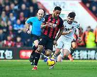 Joshua King of AFC Bournemouth gets away from Ruben Neves of Wolverhampton Wanderers during AFC Bournemouth vs Wolverhampton Wanderers, Premier League Football at the Vitality Stadium on 23rd February 2019