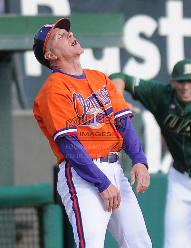 Head coach Jack Leggett (7) reacts after designated hitter Phil Pohl (9) of the Clemson Tigers is tagged out trying to reach third base on a throwing error in a game against the University of Alabama-Birmingham on Feb. 17, 2012, at Doug Kingsmore Stadium in Clemson, South Carolina. UAB won 2-1. (Tom Priddy/Four Seam Images)