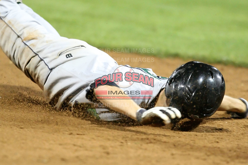 September 5, 2009:  Shortstop Chris Wade (23) of the Jamestown Jammers does a face pant while sliding into third base during a game at Dwyer Stadium in Batavia, NY.  The Jammers are the NY-Penn League Short-Season Class-A affiliate of the Florida Marlins.  Photo By Mike Janes/Four Seam Images