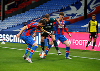 29th June 2020; Selhurst Park, London, England; English Premier League Football, Crystal Palace versus Burnley Football Club; Erik Pieters of Burnley being challenged by James McCarthy and Scott Dann of Crystal Palace