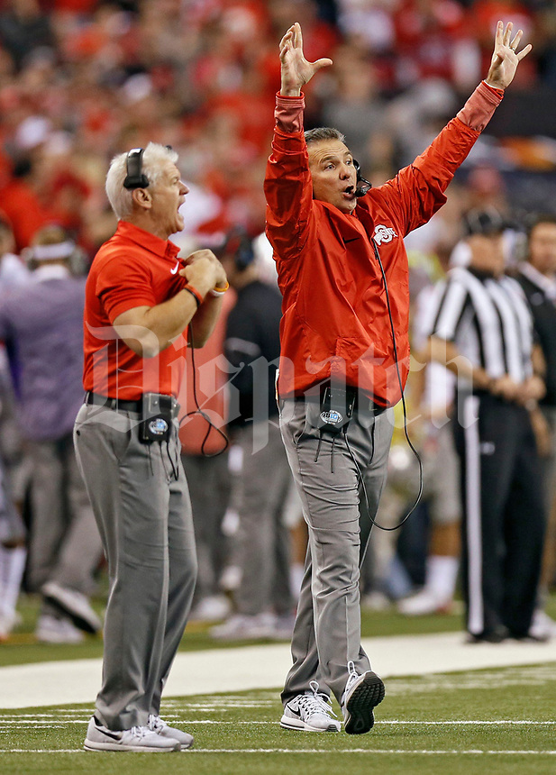 Ohio State Buckeyes head coach Urban Meyer calls a play against Wisconsin Badgers in the 2nd half of their Big Ten Championship game at the Lucas Oil Stadium in Indianapolis, Ind on December 2, 2017.  [Kyle Robertson/Dispatch]