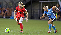 Portland, Oregon - Saturday July 2, 2016: Portland Thorns FC midfielder Amandine Henry (28) dribbles away from Sky Blue FC forward Leah Galton (21) during a regular season National Women's Soccer League (NWSL) match at Providence Park.