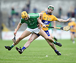 Darren O Connell of Limerick in action against Conor O Halloran of Clare during their Munster U-21 hurling quarter final at Cusack park. Photograph by John Kelly.