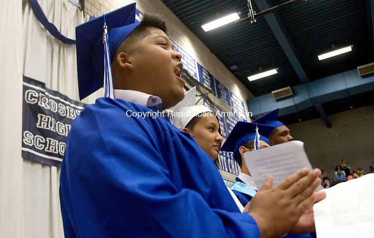 WATERBURY CT. 24 June 2013-062413SV09-Johnny Ven, 18, senior class president, cheers during the graduation ceremony at Crosby High School in Waterbury Monday.<br /> Steven Valenti Republican-American