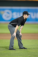 Umpire Chad Dixon handles the calls on the bases during the New York Penn League game between the Hudson Valley Renegades and the Aberdeen IronBirds at Leidos Field at Ripken Stadium on July 27, 2017 in Aberdeen, Maryland.  The IronBirds defeated the Renegades 3-0 in game two of a double-header.  (Brian Westerholt/Four Seam Images)