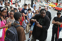 A street magician captivates his young urban audience in downtown Toronto, Canada outside of The Toronto Eaton Centre