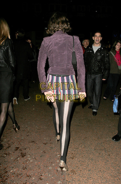 """JASMINE GUINNESS.The UK Film Premiere of director Martin Scorsese's """"Shine A Light"""" documentary featuring The Rolling Stones, held at Odeon cinema, Leicester Square, London, England..April 2nd, 2008.full length purple suede jacket print patterned mini skirt tights snakeskin shoes black striped stripes back behind rear pattern criss cross .CAP/AH.©Adam Houghton/Capital Pictures."""