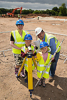 Surveying all before them - Matthew Beet (7) and Fay Spate (6)  and Abey Primary School Head Kim Wakefield take a look at their new £4M school site along with Contractor Kier's Site Manager Dave Sessions.