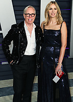 BEVERLY HILLS, CA - FEBRUARY 24: Tommy Hilfiger, Dee Ocleppo at the 2019 Vanity Fair Oscar Party at the Wallis Annenberg Center for the Performing Arts on February 24, 2019 in Beverly Hills, California. (Photo by Xavier Collin/PictureGroup)
