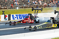 Jun 11, 2017; Englishtown , NJ, USA; NHRA top fuel driver Leah Pritchett (left) races alongside teammate Tony Schumacher during the Summernationals at Old Bridge Township Raceway Park. Mandatory Credit: Mark J. Rebilas-USA TODAY Sports