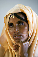 Eritrea. Anseba province. Hagaz. BBehavioural Change Communication (BCC). A black woman, wearing a yellow veil on her head to cover her hair, listens to a lecture on HIV Aids. The Global Fund through the eritrean Ministry of Health supports the programm with a Aids grant (financial aid).   © 2006 Didier Ruef