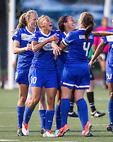 In a National Women's Soccer League Elite (NWSL) match, the Boston Breakers defeated the Western New York Flash  2-1, at Dilboy Stadium on May 5, 2013.   Team members celebrate a Breakers' goal.