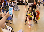 Kairi and Aiden Cave have their photo taken with Lance Walton dressed as Darth Maul at Space City Comic Con at NRG Center Saturday May 28,2016(Dave Rossman Photo)