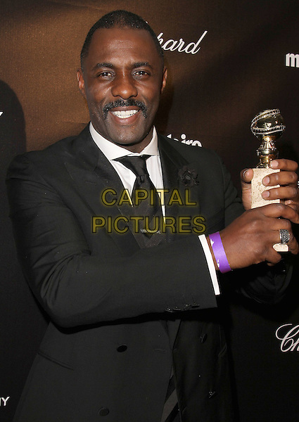 Idris Elba.The Weinstein Company 2012 Golden Globe Awards After Party held at  Bar 210 at the Beverly Hilton Hotel, Hollywood, California, USA..January 15th, 2012.globes half length black suit tie white shirt moustache mustache facial hair award trophy winner .CAP/ADM/CH.©Charles Harris/AdMedia/Capital Pictures
