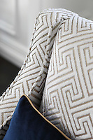 Detail of the complex, geometric weave of the living room armchairs