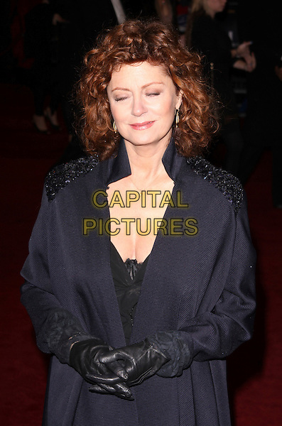 SUSAN SARANDON .Attending the Royal Film Premiere of 'The Lovely Bones' at the Odeon, Leicester Square, London, England, UK, November 24th 2009. .half length navy blue coat collar beaded shoulders  eyes shut blinking funny gloves hands leather black .CAP/AH.©Adam Houghton/Capital Pictures.