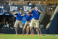 "The Durham Bulls grounds crew dances to ""Shake it Off"" as the drag the infield between innings of the International League game against the Scranton/Wilkes-Barre RailRiders at Durham Bulls Athletic Park on May 15, 2015 in Durham, North Carolina.  The RailRiders defeated the Bulls 8-4 in 11 innings.  (Brian Westerholt/Four Seam Images)"