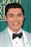 HOLLYWOOD, CA - AUGUST 7: Henry Golding at the premiere of Crazy Rich Asians at the TCL Chinese Theater in Hollywood, California on August 7, 2018. <br /> CAP/MPI/DE<br /> &copy;DE//MPI/Capital Pictures