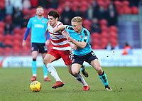 Kyle Dempsey of Fleetwood Town battling against John Marquis of Doncaster Rovers during the Sky Bet League 1 match between Doncaster Rovers and Fleetwood Town at the Keepmoat Stadium, Doncaster, England on 17 February 2018. Photo by Leila Coker / PRiME Media Images.