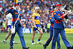 Clare captain Pat O Connor marches behind the band with his team before their quarter final against Tipperary at Pairc Ui Chaoimh. Photograph by John Kelly.