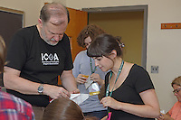 OrigamiUSA 2016 Convention at St. John's University, Queens, New York, USA. Creasers in Robert Lang's class on his design Classical Cicada. Heather Willensky (r), New York, gets help from Robert Lang.