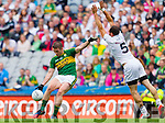 Stephen O'Brien, Kerry in action against Kevin Murnaghan, Kildare in the All Ireland Quarter Final at Croke Park on Sunday.