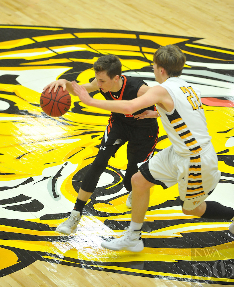 NWA Democrat-Gazette/MICHAEL WOODS • @NWAMICHAELW<br /> The Gravette Lions vs the Prairie Grove Tigers Tuesday January 26, 2016 during their game at Prairie Grove High School.