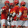 Jake Sexton #2 of Chaminade, third from left, gets congratulated by teammate Thomas Rogan #28 after scoring a goal in the Nassau-Suffolk CHSAA varsity boys lacrosse Class AA final against St. Anthony's at Mitchel Athletic Complex on Tuesday, May 15, 2018. The game went to halftme tied 8-8 when a prolonged lightning storm forced a postponement.