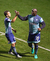 Adebayo Akinfenwa of Wycombe Wanderers celebrates his goal with Scott Kashket of Wycombe Wanderers  during the The Checkatrade Trophy match between Wycombe Wanderers and West Ham United U21 at Adams Park, High Wycombe, England on 4 October 2016. Photo by Andy Rowland.