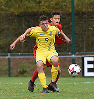 20190927 - WOLVERTEM , BELGIUM : Belgian Sofiane Et Taibi (red) and Ukraine's Denys Pochapskyi (9) pictured during the friendly  soccer match between  under 16 teams of  Belgium and Ukraine , in Wolvertem , Belgium . Thursday 26 th September 2019 . PHOTO SPORTPIX.BE / DIRK VUYLSTEKE