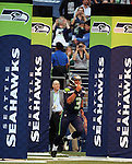 Seattle Seahawks' quarterback Russell Wilson is introduced before they take to the field against the Chicago Bears in a pre-season game at CenturyLink Field in Seattle, Washington on August 12, 2014.  Seattle beat Chicago 34-6. © 2014  Jim Bryant Photo. ALL RIGHTS RESERVED.