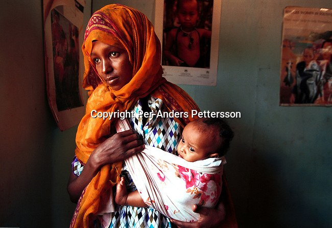 A Somali refugee women with her baby in an UNHCR office on July 24, 1998 in Kakuma, Kenya. Thousands of refugees are in Kenyan refugee camps run by the United  Nations. Many people have fled Somalia because of tribal fighting  .(Photo: Per-Anders Pettersson/ Getty Images)