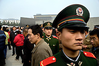"Soldiers help control the crowd as visitors flock into the grounds of the Memorial Hall of the Nanjing Massacre in Nanjing, China, on Thursday, Dec. 13, 2007.  After two years of renovations, the Memorial Hall of the Nanjing Massacre reopened to the public on Dec. 13, 2007, the 70th anniversary of the 6-week massacre by Japanese troops that started Dec. 13, 1937 and claimed more than 300,000 lives.  The commemoration comes amid renewed controversy about the accuracy of historical accounts of the massacre.  The massacre is also known as ""The Rape of Nanking."""