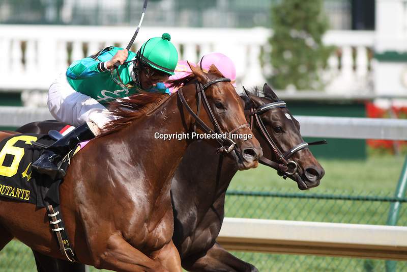 Just Louise with Robby Albarado (green cap) out duels Salty Strike and Calvin Borel (pink cap) to win the 110th running of The Debutante (grIII) at Churchill Downs. 06.26.2010