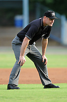 First base umpire Scott Costello during a game against the Augusta GreenJackets and the Asheville Tourists at McCormick Field on June 27, 2013 in Asheville, North Carolina. The Tourists won the game 10-6. (Tony Farlow/Four Seam Images)