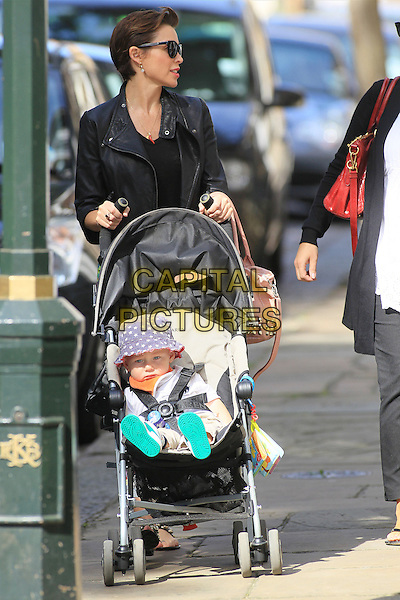 Dannii Minogue & son Ethan .spotted in Chelsea, London, England 15th September 2012..full length beige cream bag studded studs black leather biker jacket t-shirt sunglasses pushchair stroller baby mother family  mum star print hat buggy .CAP/HIL.©John Hillcoat/Capital Pictures.