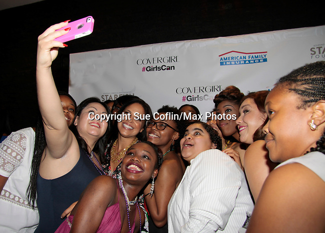 Soledad O'Brien and girls do a selfie at Soledad O'Brien and Brad Raymond Starfish Foundation presents New Orleans to New York City 2014 Gala on July 24, 2014 at Espace, New York City for VIP Cocktail Reception, dinner, entertainment with Grammy Award winning Trumpeteer Irvin Mayfield (also Board president) and the New Orleans Jazz Orchestra. (Photo by Sue Coflin/Max Photos)