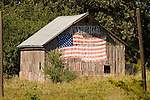 Wooden barn with US flag painted on it:.America, Proud of It