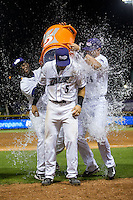 Adam Engel (5) of the Winston-Salem Dash is doused with water by teammates Marcus Davis (left) and Sean O'Connell (right) following his walk-off single in the bottom of the 11th inning against the Potomac Nationals at BB&T Ballpark on May 13, 2016 in Winston-Salem, North Carolina.  The Dash defeated the Nationals 5-4 in 11 innings.  (Brian Westerholt/Four Seam Images)