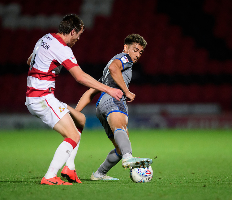 Lincoln City's Tyler Walker vies for possession with Doncaster Rovers' Tom Anderson<br /> <br /> Photographer Chris Vaughan/CameraSport<br /> <br /> EFL Leasing.com Trophy - Northern Section - Group H - Doncaster Rovers v Lincoln City - Tuesday 3rd September 2019 - Keepmoat Stadium - Doncaster<br />  <br /> World Copyright © 2018 CameraSport. All rights reserved. 43 Linden Ave. Countesthorpe. Leicester. England. LE8 5PG - Tel: +44 (0) 116 277 4147 - admin@camerasport.com - www.camerasport.com