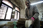 A Palestinian blind man works in making brooms at a workshop in the Old City of Jerusalem on Dec. 07, 2013. The workshop is owned and managed by the Arab Blind Association, which was founded by blind Palestinians in 1932, and has then set up a number of workshops employing blind Arabs, as well as offering financial aid projects to blind. Photo by Saeed Qaq