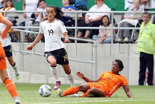 07 06 2011  Womens International Football. Germany versus Holland.  in Aachen.  Fatmire Bajramaj Germany drives past Dyanne Bito Netherlands.